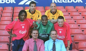 Gary McAllister poses with Liverpool's other summer signings, as well as Phil Thompson, bottom left, and Gerard Houllier ahead of the 2000-01 season