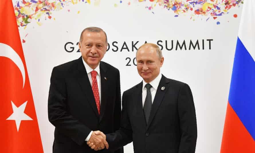 President Erdoğan shakes hands with Vladimir Putin in Osaka, June 2019.