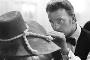 Givenchy adjusting a hat