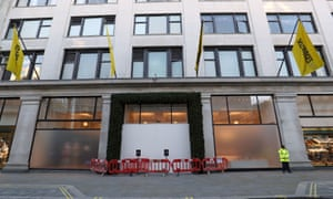An entrance to Selfridges department store was boarded up after the ram-raid.