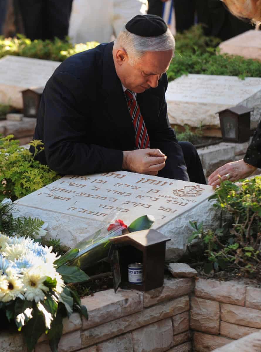 Binyamin Netanyahu at the grave of his brother, Yoni.