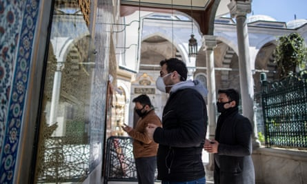 Worshippers wearing face masks pray at Istanbul's Eyüp Sultan mosque.