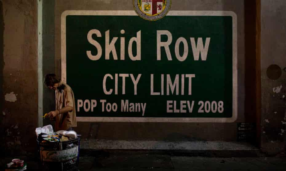 In this 28 October 2017 file photo, a homeless man takes food from a trash can in Los Angeles' Skid Row area, home to the nation's largest concentration of homeless people.