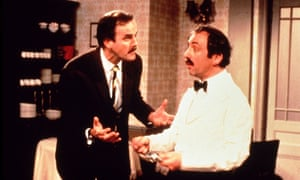 Scene from the classic British sitcom Fawlty Towers starring John Cleese as Basil Fawlty and Andrew Sachs as Manuel