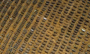 BRAZIL-HEALTH-VIRUS-CEMETERYAerial view showing graves in the Nossa Senhora Aparecida cemetery in Manaus, Brazil, on Monday. Brazil's death toll has passed 80,000.