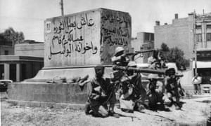 Revolutionary soldiers in a street of Baghdad, Iraq, July 14, 1958.
