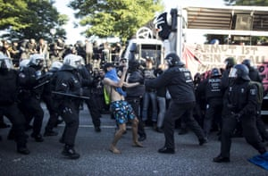 Demonstrators scuffle with police