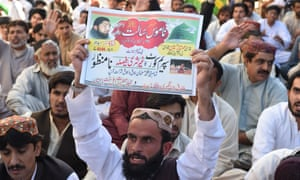 Supporters of Mumtaz Qadri hold placards bearing slogans expressing opposition to Pakistan's supreme court verdict on Wednesday.