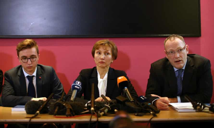Marina Litvinenko and her son Anatoly listen as their lawyer, Ben Emmerson, speaks during a press conference on 21 January