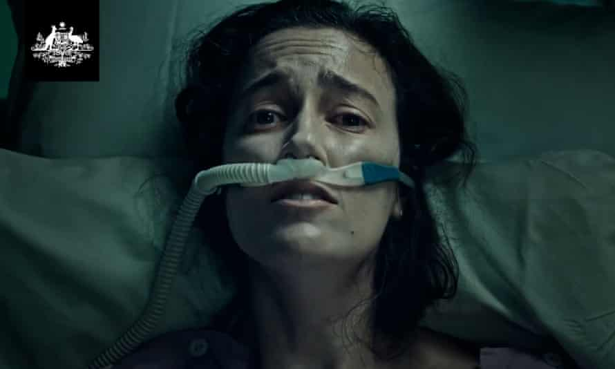 A screen grab from the Australian federal government's Covid-19 campaign showing a young woman in a hospital bed gasping for air
