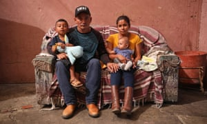 Santo Catalino López Velásquez poses for a portrait after a 36-hour stint in the freezing hielera (icebox) detention center with his baby daughter and toddler son inside a shelter for immigrants in Mexicali, Mexico.