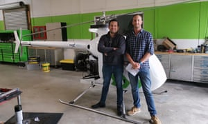 Samuel Vye and Cameron Baker of ECT with the helicopter they are developing into a drone for New Zealand trials.