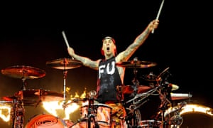 Inspired drumming lunacy … Travis Barker of Blink 182 performs amid jets of fire at the Echo Arena, Liverpool.