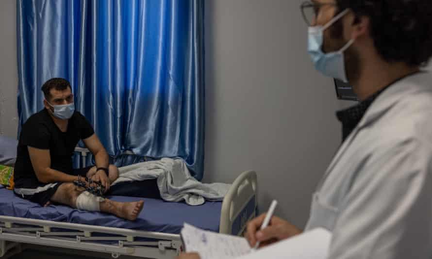 Dr Mohammed Qumboz with Mohammed al-Mughari at Gaza's Nasser hospital.