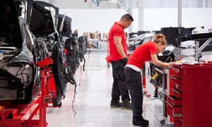 This handout photo made available by Tesla Motors on 3 July 2017 shows workers at the Fremont factory in California, in 2012.