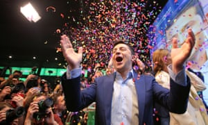 Volodymyr Zelenskiy reacts to the announcement of an exit poll in Ukraine's presidential election, which he won by a landslide.