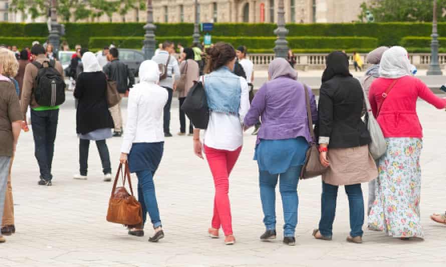 Women wear headscarves in Paris