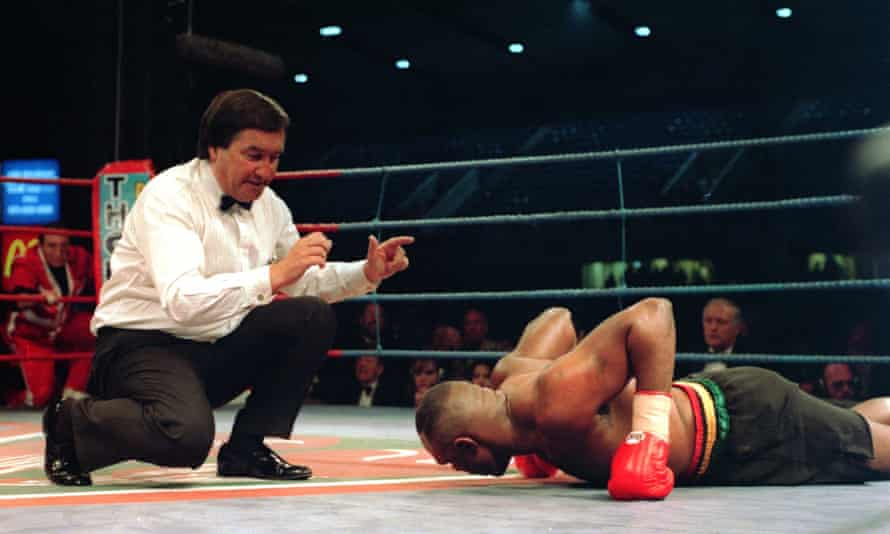Michael Bentt is beaten by the count as he loses his world title to Herbie Hide in London in 1994.