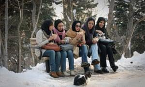Women eat in the park in Tehran.