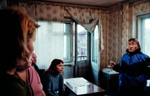 Irina in the last inhabited building in Yur-ShorIrina, an Olympic table-tennis coach, talks with her neighbours Sergei, Svetlana, Irina and Katya. They were the last inhabitants of the town of Yur-Shor before the government turned out the electricity.