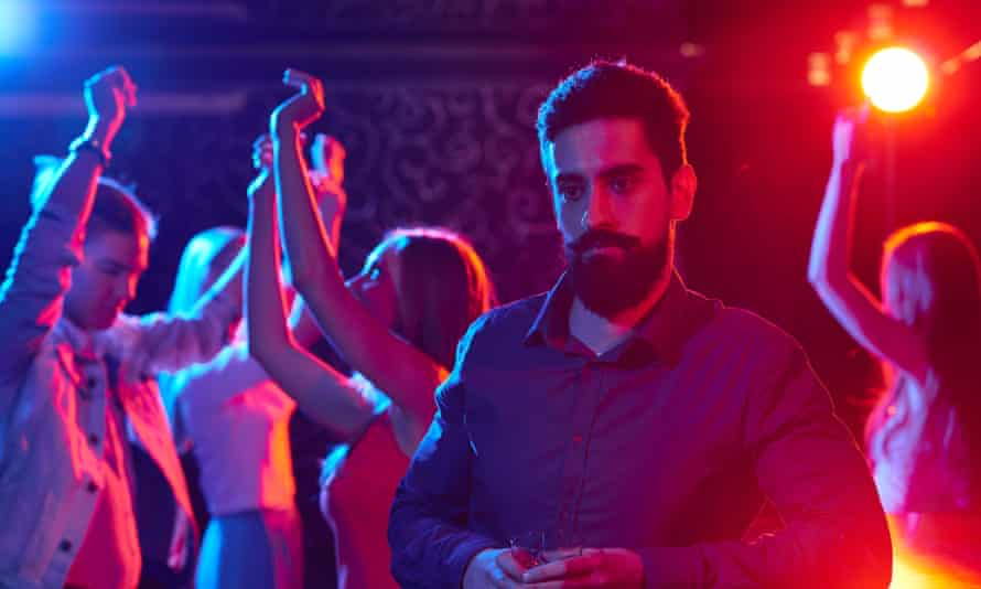 Morose man in a nightclub