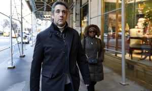 Michael Cohen leaves his apartment building in New York City on 7 December.