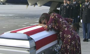 Myeshia Johnson cries over the casket of her husband, Sgt La David Johnson, who was killed in an ambush in Niger.