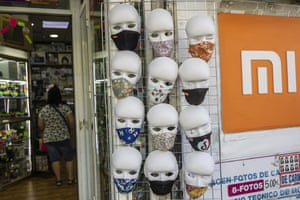 Face protection masks for sale are displayed in a shop in Madrid, Spain.