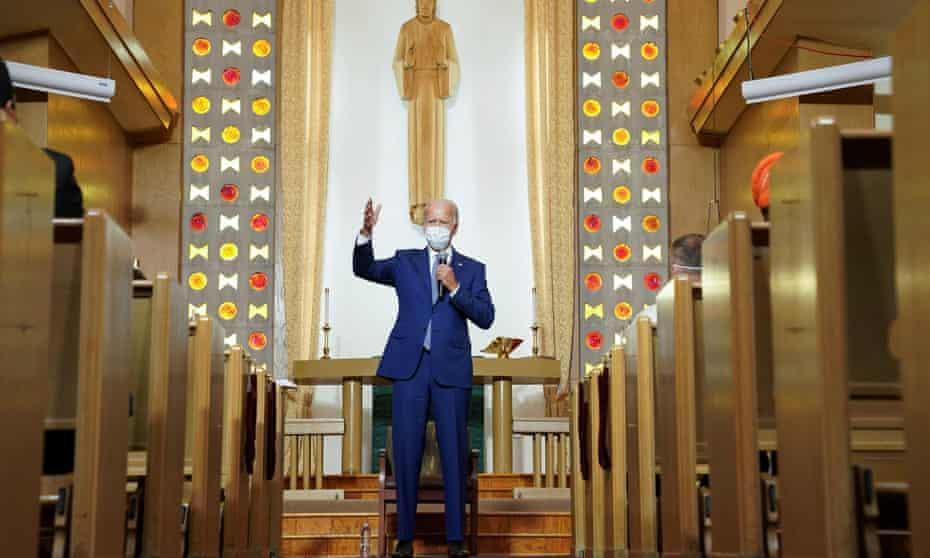 Joe Biden speaks to residents during a community meeting at Grace Lutheran church in Kenosha.