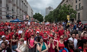 Protesters gather in the streets during a North Carolina public school teacher march and rally in Raleigh, North Carolina, on 16 May 2018.