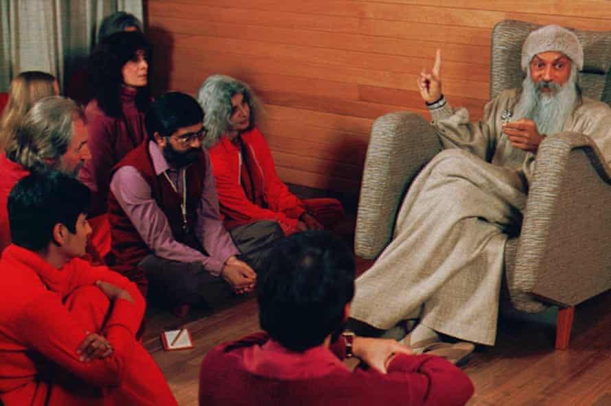 Bhagwan Shree Rajneesh, right, speaks with followers