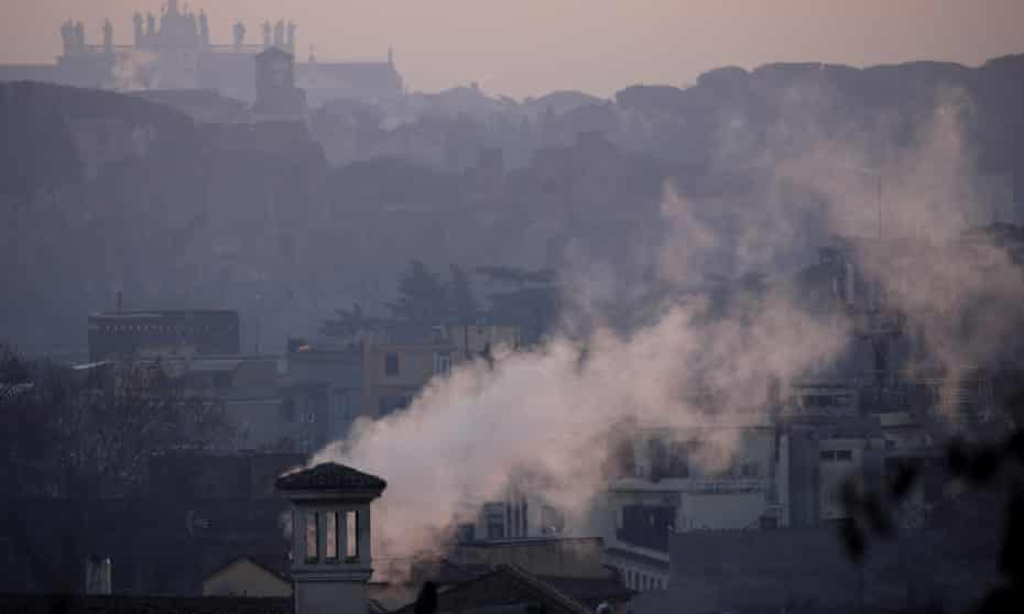 Smoke rises from buildings in Rome