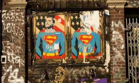 faded and torn posters of Barack Obama as superman on a wall in New York City