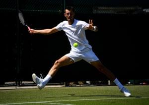 Bernard Tomic in action during Wimbledon qualifying