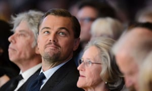 """US actor Leonardo DiCaprio (2nd L) looks on during the 22nd Annual Crystal Awards at the opening of the World Economic Forum (WEF) in Davos on January 19, 2016. More than 40 heads of states and governments attend the WEF in Davos, which this year is focused on """"mastering the fourth Industrial Revolution,"""" organisers said. / AFP / FABRICE COFFRINIFABRICE COFFRINI/AFP/Getty Images"""