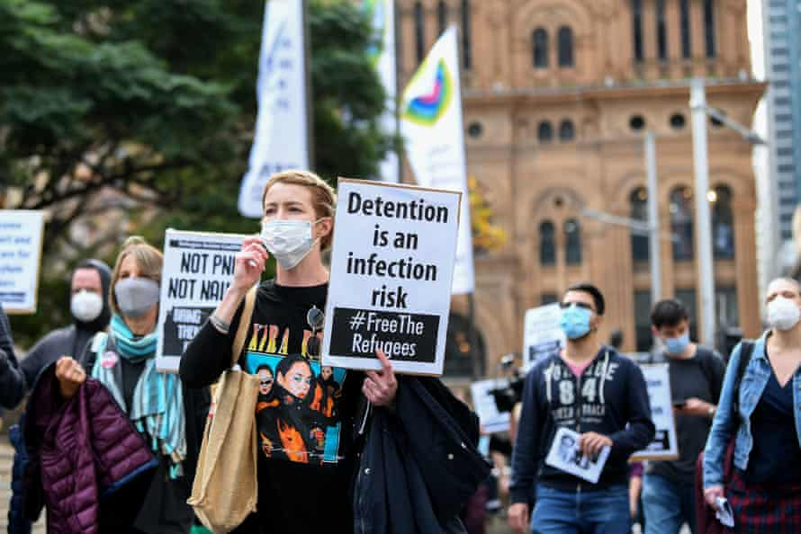 Protesters hold placards during a 'Free the refugees' rally at Sydney's Town Hall