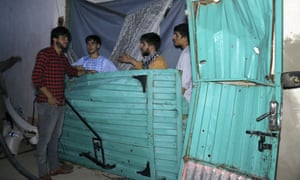 The broken door of a house is seen after the US drone strike in Kabul, Afghanistan, 29 August.