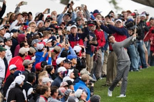 The crowd stares on as Rory McIlroy swings from the rough during a practice round ahead of 41st Ryder Cup at Hazeltine National Golf Course, Chaska, Minnesota.