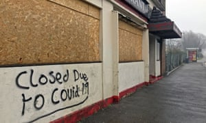 A boarded-up pub in Swansea