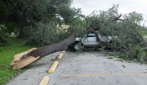 The flash floods uprooted trees and destroyed cars in the Hyde park district of Austin.