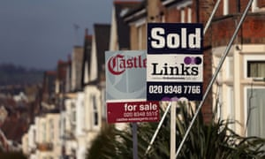 Estate agents' signs outside houses in north London