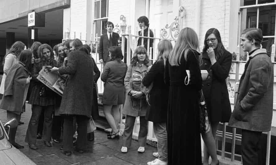 Beatles fans gathered outside the London office of Apple, some reading a newspaper story which said that Paul McCartney was leaving the group, 10 April 1970.