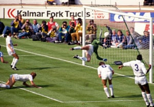 The ball flies off the knee of Gary Mabbutt and over Spurs keeper Ray Clemence and Coventry have the lead for the first time in the game