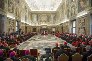 Pope Francis (centre) exchanges Christmas greetings with the curia in Clementine Hall, Vatican City.