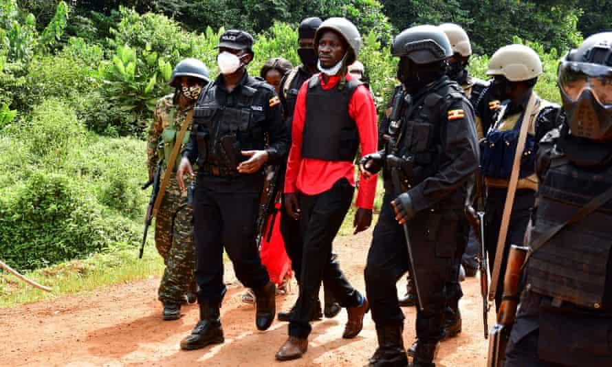 Bobi WIne (centre) during his arrest on Wednesday.