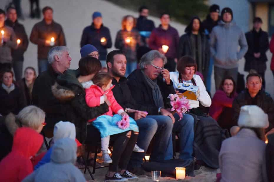 The family of Justine Damond take part in a vigil for their daughter at Freshwater Beach in Sydney on 19 July.