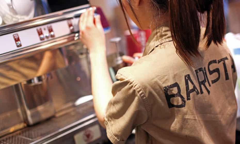 a barista prepares coffee