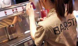 Female barista at a Costa Coffee shop.