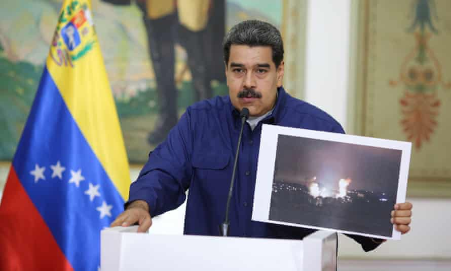 Venezuela's President Nicolas Maduro speaks during a broadcast at Miraflores Palace in Caracas