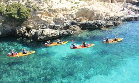 FOur kayaks in blue sea, Gozo